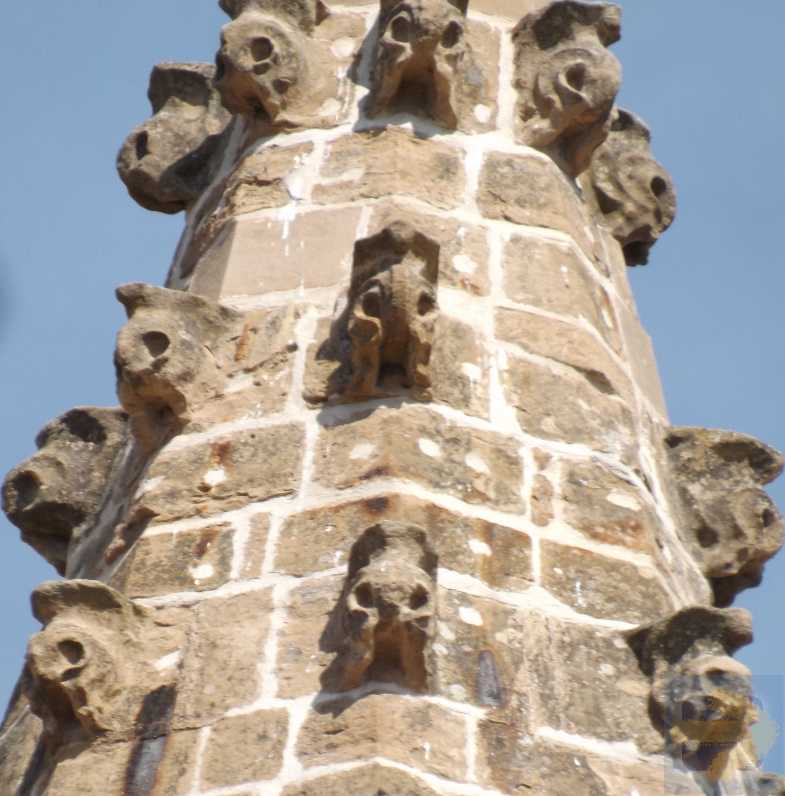 Tower of spooky heads taken from cloister Santa Maria Pamplona